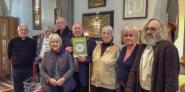Keith Taylor MEP, holding his latest foodbank report, meets Rev Andrew Cunnington, far left, and volunteers at Redhill foodbank at St Matthew's Church, Surrey